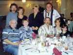 Left to Right Standing: Hershey Mayoff and guest, Eva and Allan Mayoff. Sitting: Stanley Mayoff and Sharon Mayoff, Barry Mayoff and guests.