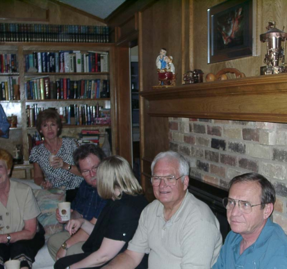 Robin Caldwell, Shirley Howard. Kay Adcock, Ron Thomas, Barbara Thomas, Jim Howard, Butch Wiseman. This picture shows an official Mayoff Day goblet, with the ancient Mayoff Seal emblazoned upon it, in Ron's hand. Covering all bases, on the mantle and overlooking the celebration are a figure of a rabbi and three obsidian carvings of Teotihuacan Mesoamerican idols.