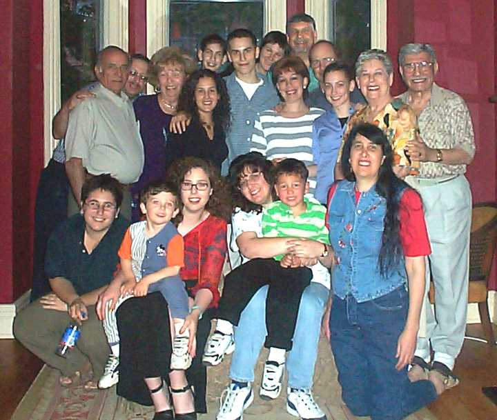 Group photo: Front Row: Ali Vamos (Sam), Adam and Jennifer Fineberg Scott (Soc), Debbie, Mattie and Sue Mayoff (Sam). Standing: Walter Berman (Abr), Art Mayoff (Sam), Barbara Berman (Abr), Jeffrey Cappe. In front of [ ] is Tiana Roebuck. Jeffrey Cappe, Gerry Solomons, Cheryl Cappe, Stephen Solomons, Len Cappe, Sonia Cappe, Beatrice and Syd Solomons. (Soc)