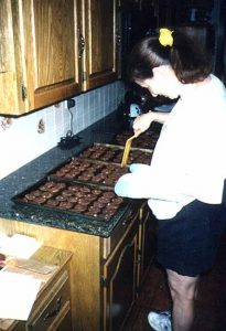 Denise prepares traditional Mayoff Day cookies