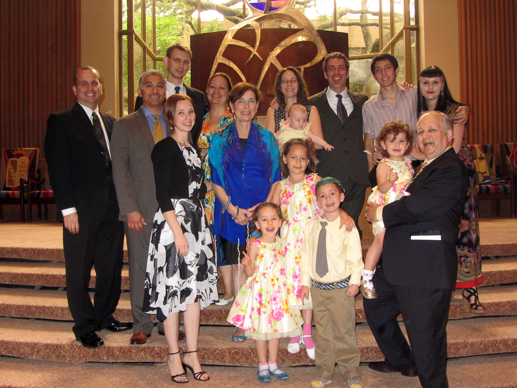 Denise surrounded by her family on the bimah following her bat mitzvah