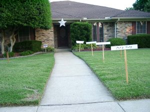 Walk way with star over the end of the walkway, signs lining path