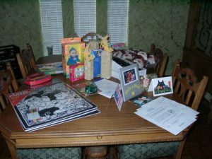 Table with several gifts for Make a Wish children