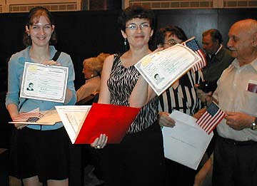 Anna, Mila, Zina (partially hidden) Elperin and friend Matvey holding citizenship certificates